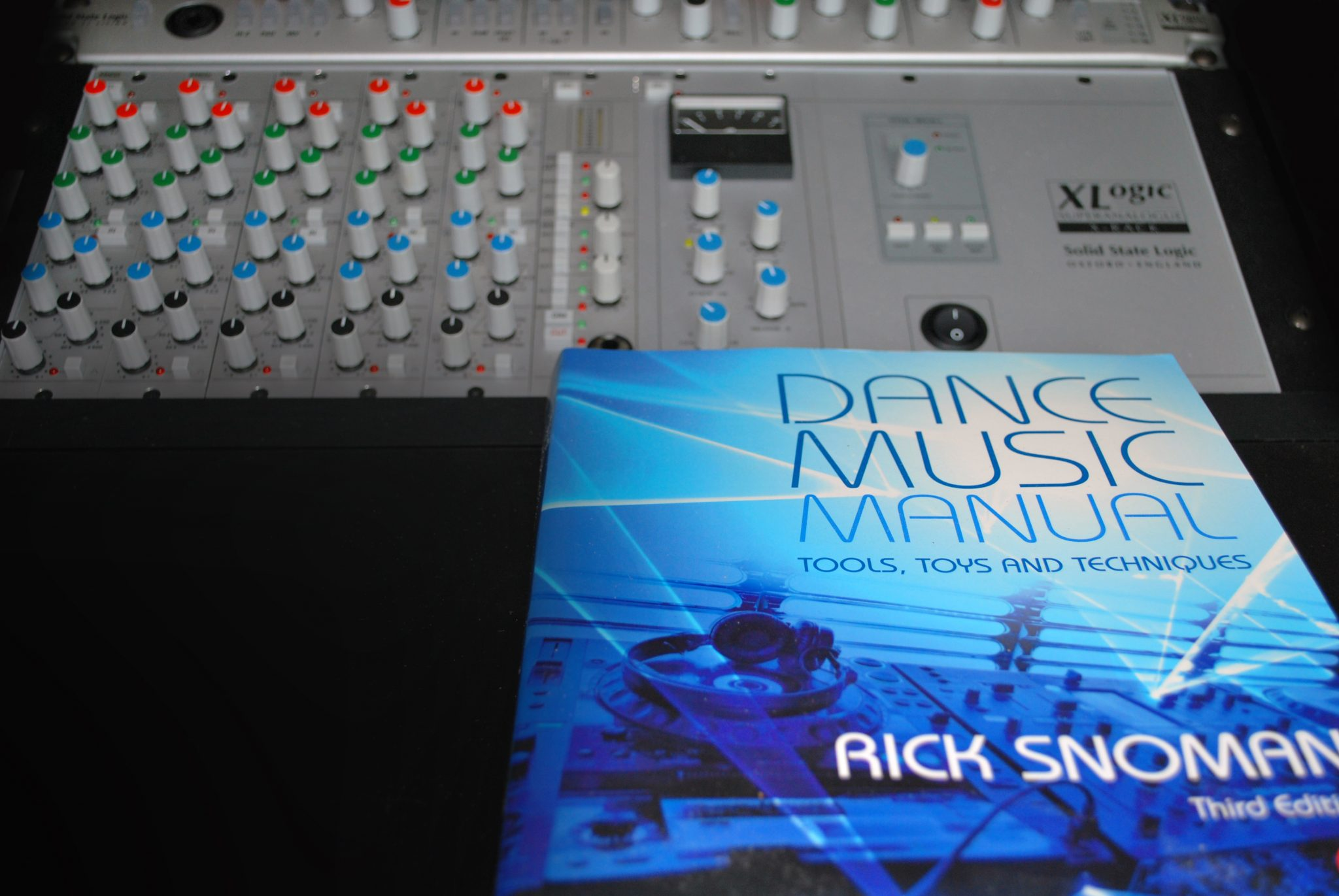 Dance Music Manual on a desk